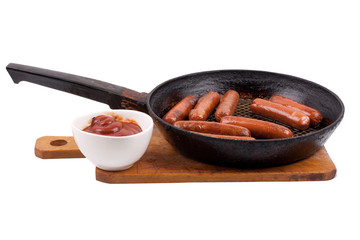 sausages in a pan with tomato sauce