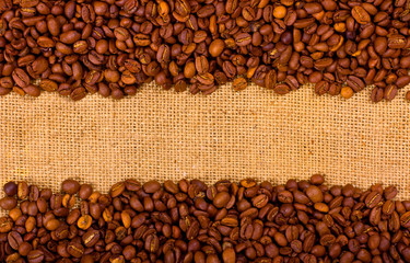 Coffee grains on the burlap background