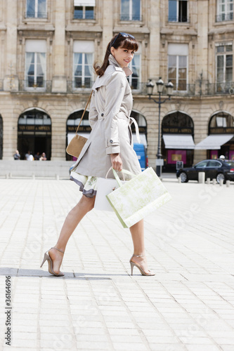 Woman walking on a street, Paris, Ile-de-France, France
