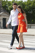 Couple walking with arms around and smiling, Paris, Ile-de-France, France