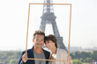 Portrait of a couple framing their dream vacation with Eiffel Tower, Paris, Ile-de-France, France