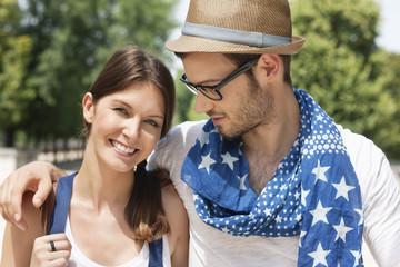 Man with his arm around a woman smiling, Paris, Ile-de-France, France