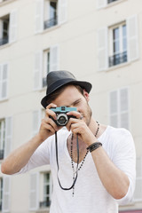 Man taking a picture with a camera, Paris, Ile-de-France, France