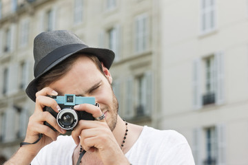Man photographing with a camera, Paris, Ile-de-France, France