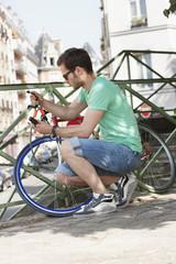 Man locking his bicycle, Paris, Ile-de-France, France