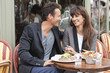 Romantic couple at a restaurant, Paris, Ile-de-France, France
