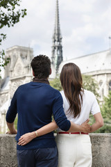 Romantic couple with Notre Dame de Paris in the background, Paris, Ile-de-France, France