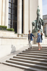 Couple moving down steps of a museum, Musee de l'Homme, Paris, Ile-de-France, France