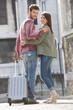 Couple walking on a road with a suitcase, Paris, Ile-de-France, France