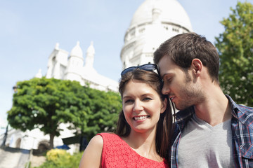 Man kissing a woman smiling, Montmartre, Paris, Ile-de-France, France