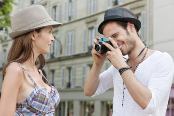Man taking a picture of a woman, Paris, Ile-de-France, France