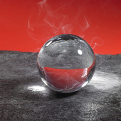 crystal ball on stone surface