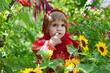 little girl in Russian national dress among sunflowers