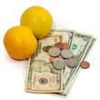 2 oranges with money