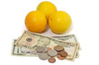 3 oranges with money