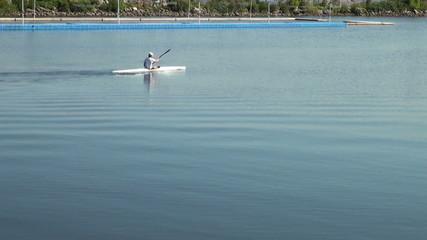 Athletic man kayaking in a lake