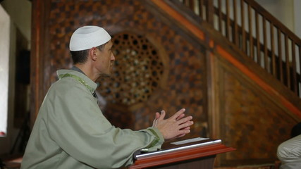 Imam preaching in a mosque