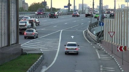 Stream of cars on a city highway