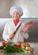 Cook woman with raw meat