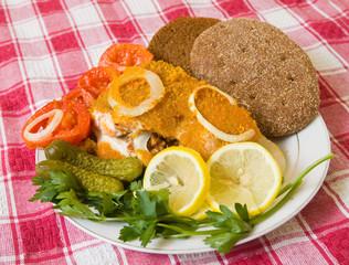 breaded fish in plate