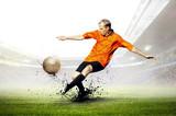 Fototapety Football player on field of stadium