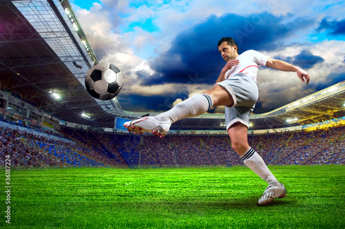 Canvas voetbal Football player on field of stadium