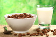 Chocolate wheat flake cereal with a glass of milk