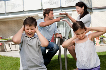 Children suffers while parents fight in background