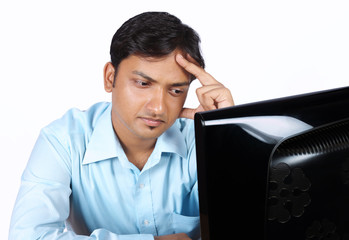 Indian young Businessman looking depressed