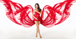 Woman in red flying waving dress as wings on a wind flow. Over w