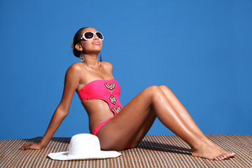 Beautiful african american woman sunbathing
