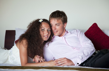 Loving couple in bed