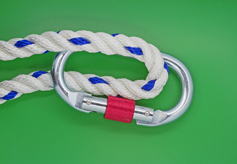 Karabiner and rope on green