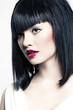 beautiful girl with perfect skin, red lipstick and black hair