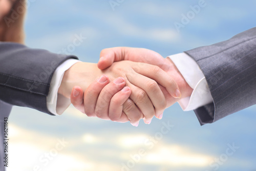 handshake in the blue sky