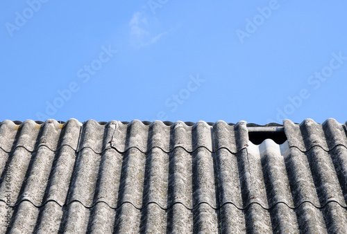 close up on corrugated asbestos roof on byre in Poland