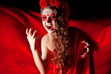 Happy Halloween, make-up girl in red cry
