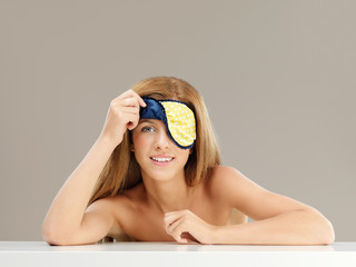 beauty portrait young woman with sleeping mask
