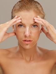 portrait beautiful woman with facial mask frowning