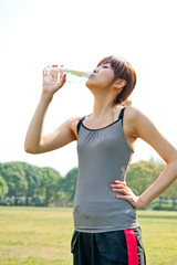 beautiful asian woman drinking pure water
