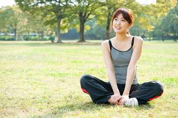 beautiful asian woman relaxing in the park