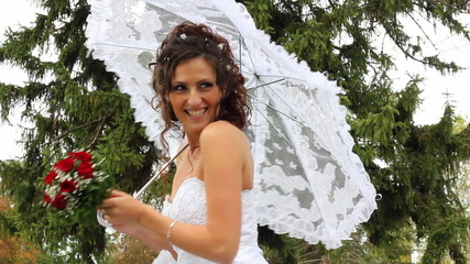 Beautiful bride sends a kiss and smiles