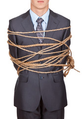 front view of businessman executive tied up with rope