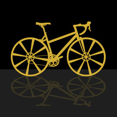 gold bicycle on black background