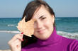 Pretty girl holding an autumn leaf