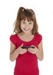 Cute little girl holding cell phone