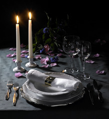 festive place setting and candlelight