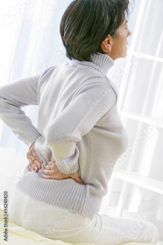 Femme - Mal de dos, lombalgie