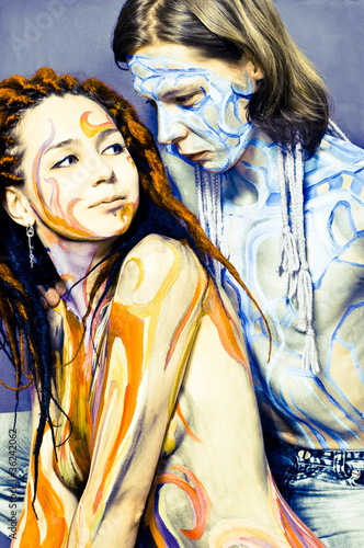 Boy and girl with body painting.