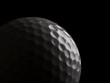 Close up of a golf ball on black